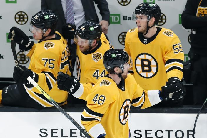 Boston Bruins' Matt Grzelcyk (48) celebrates his gaol during the second period of an NHL hockey game against the Buffalo Sabres, Saturday, March 27, 2021, in Boston. (AP Photo/Michael Dwyer)