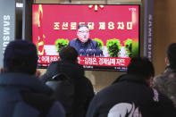People watch a TV screen showing North Korean leader Kim Jong Un during a ruling party congress, at the Seoul Railway Station in Seoul, South Korea, Wednesday, Jan. 6, 2021. Kim opened his country's first ruling party congress in five years with an admission of policy failures and a vow to set new developmental goals, state media reported Wednesday. (AP Photo/Ahn Young-joon)