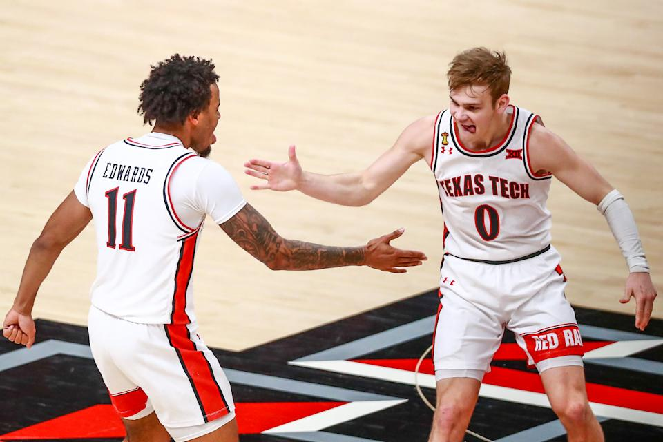 LUBBOCK, TEXAS - FEBRUARY 27: Guard Mac McClung #0 of the Texas Tech Red Raiders high fives Kyler Edwards #11 after making a three-pointer during the first half of the college basketball game against the Texas Longhorns at United Supermarkets Arena on February 27, 2021 in Lubbock, Texas. (Photo by John E. Moore III/Getty Images)