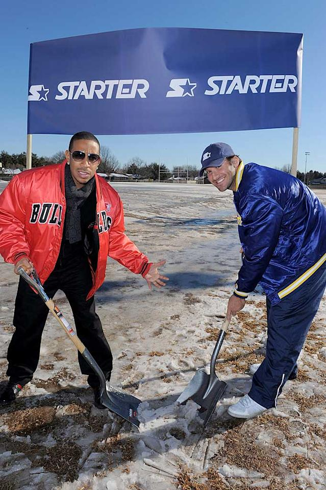 "On the morning before Super Bowl Sunday, Dallas Cowboys' quarterback Tony Romo and rapper Ludacris were snapped attempting to shovel the snow and ice off the new Starter field in Pleasant Grove, which will be the athletic hub to multiple middle and high schools in the Dallas area. Good luck guys! Jordan Strauss/<a href=""http://www.wireimage.com"" target=""new"">WireImage.com</a> - February 5, 2011"