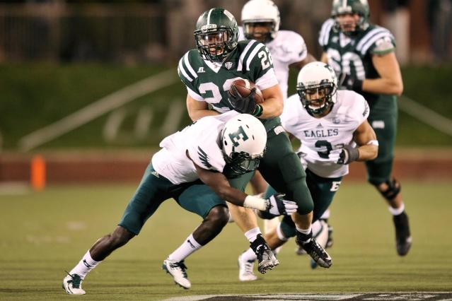 ATHENS, OH - NOVEMBER 1: Beau Blankenship #22 of the Ohio Bobcats is brought down after a 19-yard run by Darius Scott #1 of the Eastern Michigan Eagles at Peden Stadium on November 1, 2012 in Athens, Ohio. Ohio defeated Eastern Michigan 45-14. (Photo by Jamie Sabau/Getty Images)
