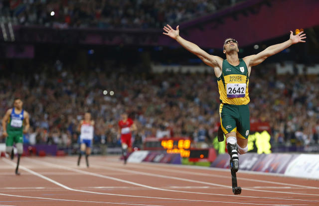 Oscar Pistorius of South Africa celebrates winning the Men's 400m T44 Final during the London 2012 Paralympic Games at the Olympic Stadium in London September 8, 2012. REUTERS/Andrew Winning (BRITAIN - Tags: SPORT OLYMPICS ATHLETICS) - RTR37PAZ