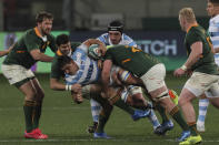 Pablo Matera of Argentina is tackled by Morne Steyn and Marco van Staden of South Africa during the first Rugby Championship match between South Africa's Springboks and Argentina at the Nelson Mandela Stadium, in Gqeberha, South Africa, Saturday, Aug. 14, 2021. (AP Photo/Halden Krog)