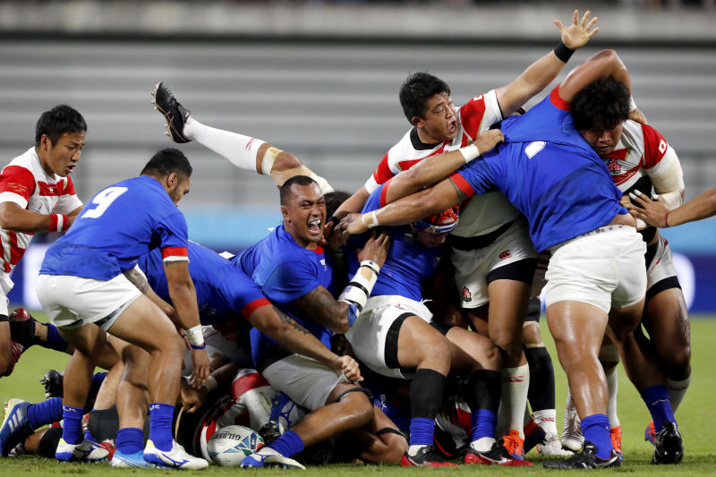 Players react as a scrum collapses during the Rugby World Cup Pool A game at City of Toyota Stadium between Japan and Samoa in Tokyo City, Japan, Saturday, Oct. 5, 2019. (AP Photo/Shuji Kajiyama)