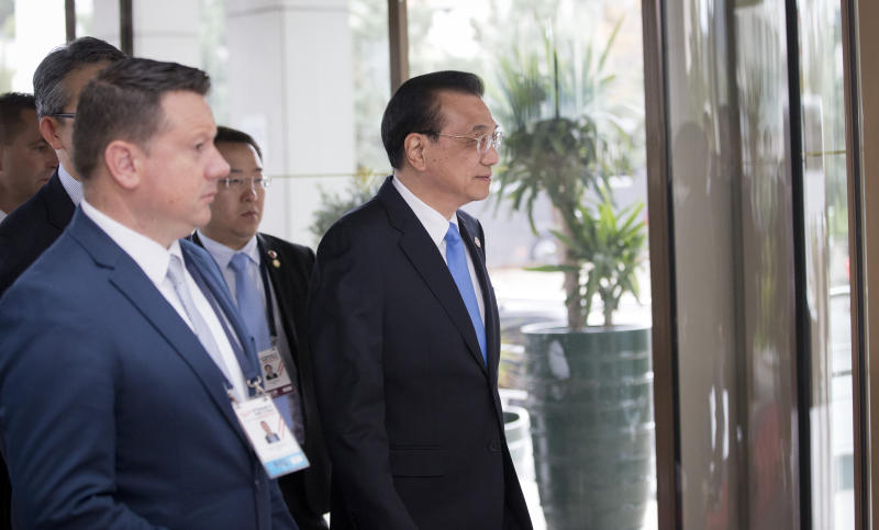 China's Prime Minister Li Keqiang, center, arrives at the Summit of Central and Eastern Europe and China in Dubrovnik, Croatia, Friday, April 12, 2019. EU member Croatia is hosting a two-day summit between China and 16 regional countries on expanding business between China and the region, which is dubbed 16+1. (AP Photo/Darko Bandic)
