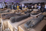 A sarcophagus that is around 2500 years old is displayed at the Saqqara archaeological site, 30 kilometers (19 miles) south of Cairo, Egypt, Saturday, Oct. 3, 2020. Egypt says archaeologists have unearthed about 60 ancient coffins in a vast necropolis south of Cairo. The Egyptian Tourism and Antiquities Minister says at least 59 sealed sarcophagi with mummies inside were found that had been buried in three wells more than 2,600 years ago. (AP Photo/Mahmoud Khaled)