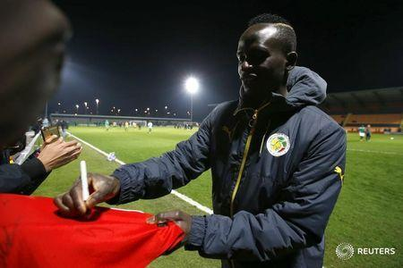 Britain Football Soccer - Nigeria v Senegal - International Friendly - The Hive, Barnet, London, England - 23/3/17 Senegal's Sadio Mane signs autographs for fans before the match Action Images via Reuters / Peter Cziborra Livepic