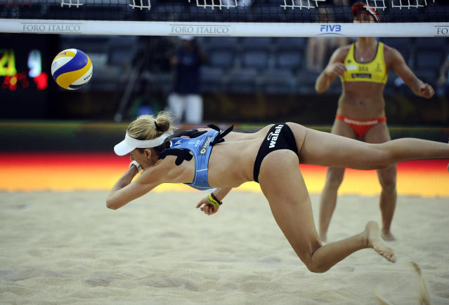 US Kerri Walsh jumps for the ball against Brazil during their FIVB Beach Volleyball World Championships final in Rome's Foro Italico on June 19, 2011. AFP PHOTO/ FILIPPO MONTEFORTE (Photo credit should read FILIPPO MONTEFORTE/AFP/Getty Images)