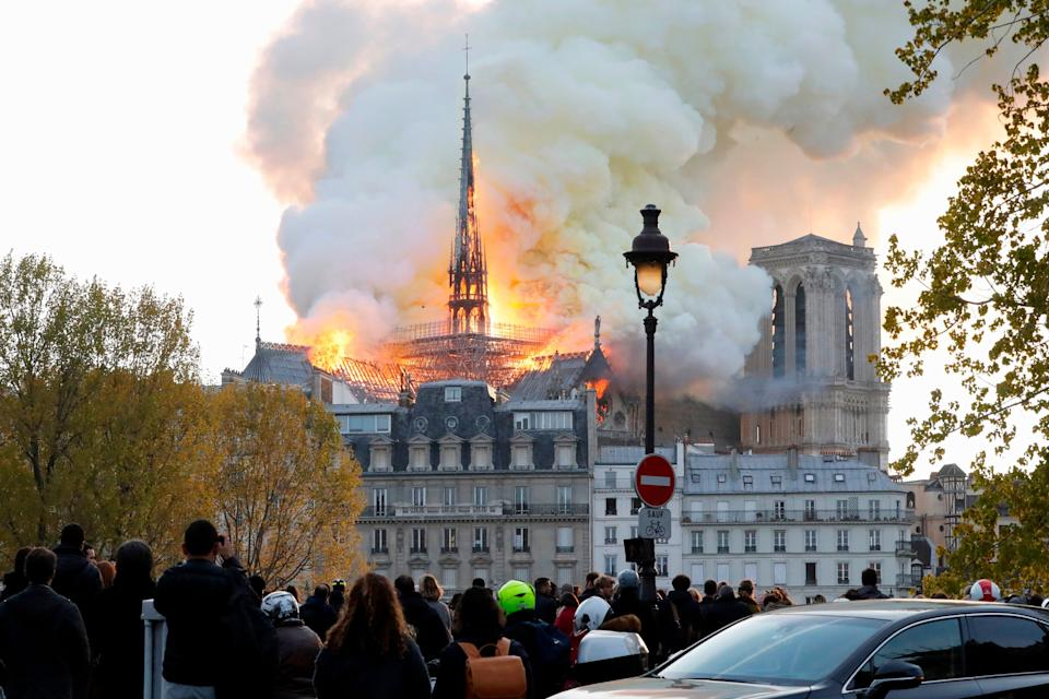 Seen from across the Seine River, smoke and flames rise during a fire at the landmark Notre-Dame Cathedral in central Paris on April 15, 2019, potentially involving renovation works being carried out at the site, the fire service said. (Photo by FRANCOIS GUILLOT / AFP)        (Photo credit should read FRANCOIS GUILLOT/AFP/Getty Images)