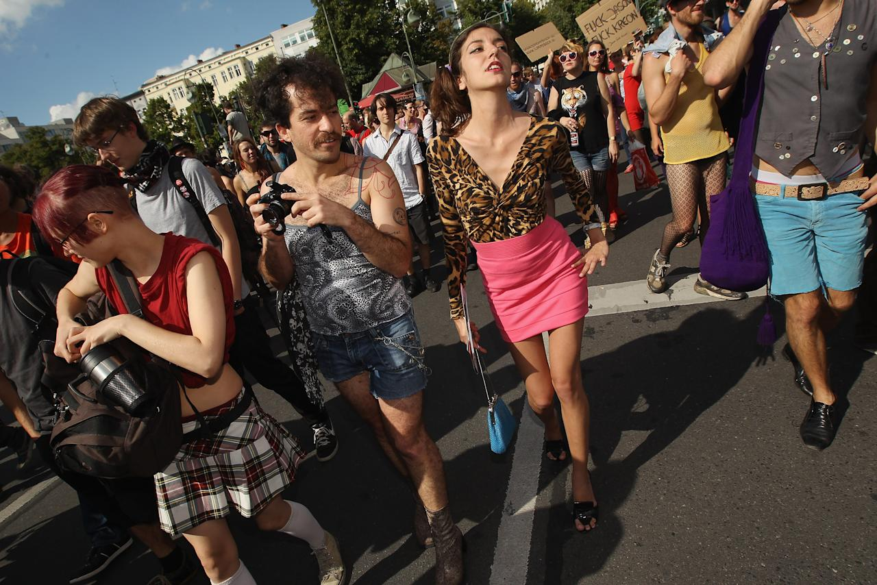 "BERLIN, GERMANY - AUGUST 13:  Women participate the ""Slut Walk"" march on August 13, 2011 in Berlin, Germany. Several thousand men and women turned out to protest against rape and a woman's right to her body.  (Photo by Sean Gallup/Getty Images)"