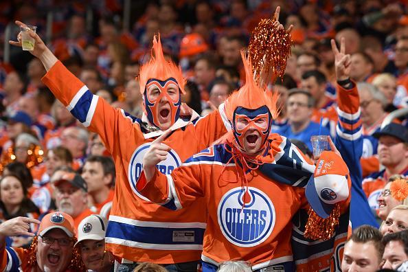 "EDMONTON, AB – APRIL 12: Fans of the <a class=""link rapid-noclick-resp"" href=""/nhl/teams/edm/"" data-ylk=""slk:Edmonton Oilers"">Edmonton Oilers</a> celebrate after a goal during Game One of the Western Conference First Round during the 2017 NHL Stanley Cup Playoffs against the <a class=""link rapid-noclick-resp"" href=""/nhl/teams/san/"" data-ylk=""slk:San Jose Sharks"">San Jose Sharks</a> on April 12, 2017 at Rogers Place in Edmonton, Alberta, Canada. (Photo by Andy Devlin/NHLI via Getty Images)"