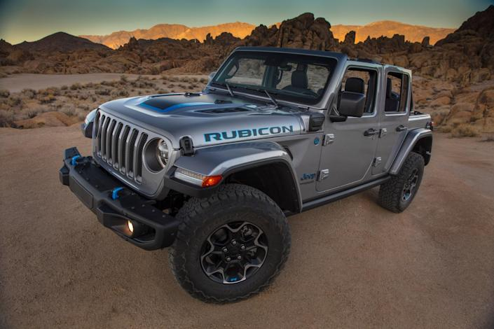 """Despite the significant decrease in overall car sales in 2020, due to production stoppages and the significant economic woes cased by the pandemic, sales of the Jeep Wrangler remained quite strong, cresting 200,000 for the third year running. <a href=""""https://www.automobilemag.com/news/jeep-gladiator-drive-review-new-zealand-learning-to-love"""" rel=""""nofollow noopener"""" target=""""_blank"""" data-ylk=""""slk:Jeeps are many things"""" class=""""link rapid-noclick-resp"""">Jeeps are many things</a>, but thrifty and efficient are not among them. That could change with the introduction of the Jeep 4XE, a plug-in hybrid with a battery pack and two electric motors that support a downsized 2.0 liter gas engine, and provides the ability to travel up to 25 miles on battery power alone."""