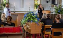 <p>Emotions run high during the service at the church.</p>