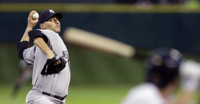 New York Yankees starting pitcher Andy Pettitte, left, throws to Houston Astros' Jose Altuve, right, during the first inning of a baseball game Saturday, Sept. 28, 2013, in Houston. (AP Photo/David J. Phillip)