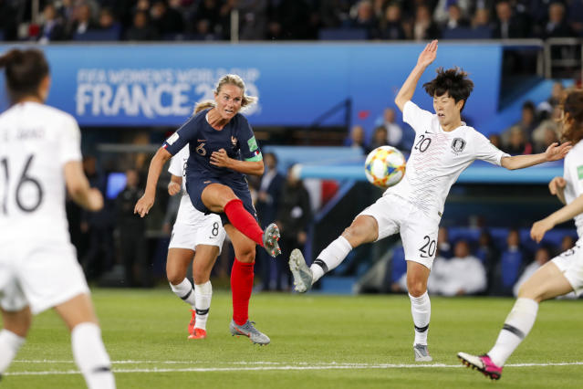 Amandine Henry #6 of France scores a goal against Hyeri Kim #20 of Korea Republic during the 2019 FIFA Women's World Cup France group A match between France and Korea Republic at Parc des Princes on June 7, 2019 in Paris, France. (Photo by Catherine Steenkeste/Getty Images)
