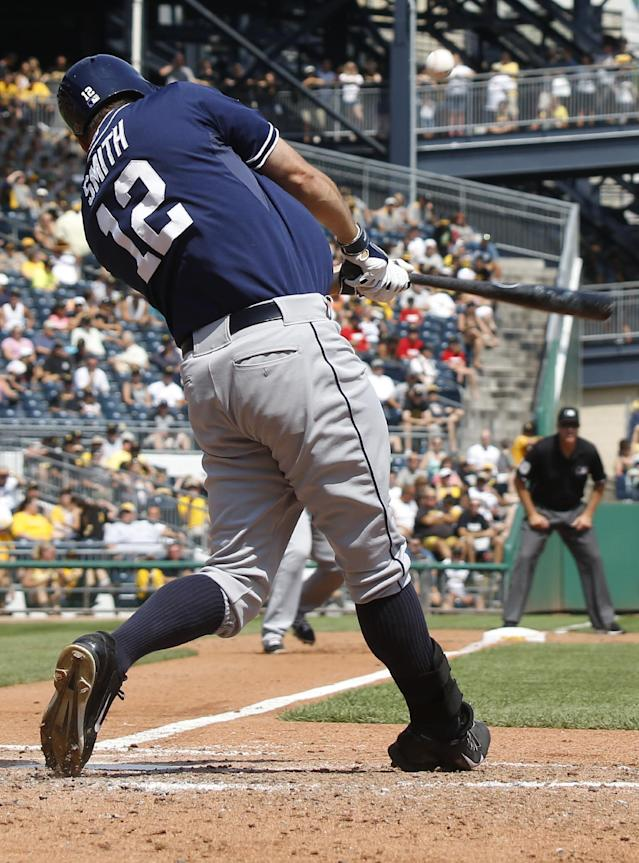 San Diego Padres' Seth Smith hits a bases-loaded triple driving in three runs against the Pittsburgh Pirates in the fifth inning of the baseball game on Sunday, Aug. 10, 2014, in Pittsburgh. (AP Photo/Keith Srakocic)