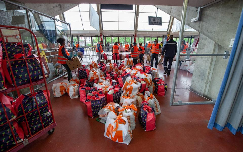 A food bank has been set up in one of Geneva's ice rinks during the coronavirus crisis - Getty Images