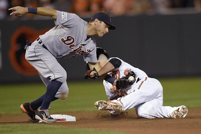 Baltimore Orioles' Steve Pearce (28) is tagged out at second by Detroit Tigers second baseman Ian Kinsler as Pearce tried to stretch a single into a double in the sixth inning during Game 1 of baseball's AL Division Series, Thursday, Oct. 2, 2014, in Baltimore. (AP Photo/Nick Wass)