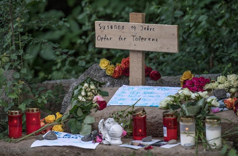 Messages, candles and flowers at a makeshift memorial at the site where 14-year-old Susanna Maria Feldman was allegedly raped and murdered by an Iraqi asylum seeker in Wiesbaden, Germany (AFP Photo/Boris Roessler)