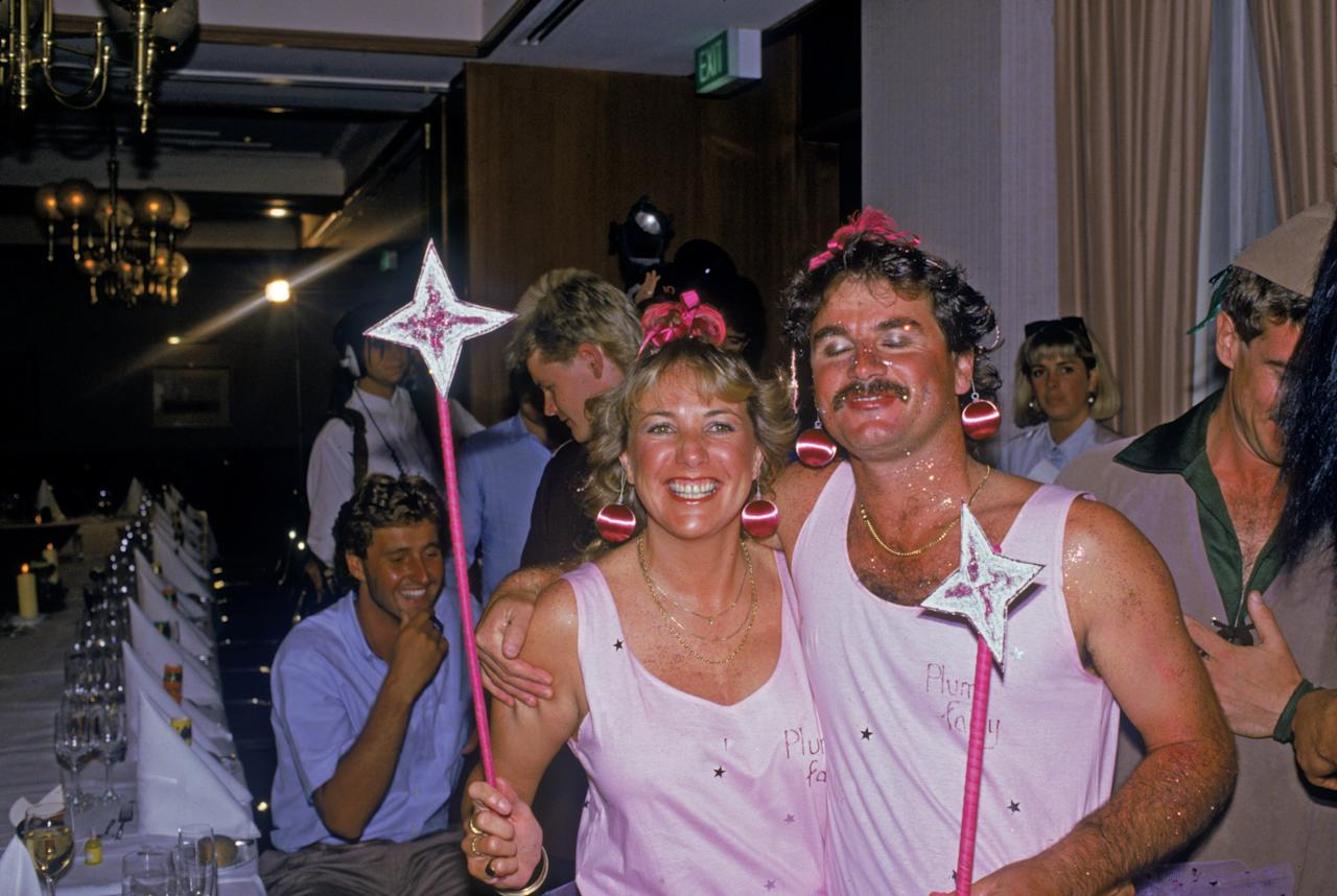 The England cricket team attend a Christmas party during their Australian tour, December 1986. South African-born Allan Lamb and his wife are dressed as 'plum fairies'. (Photo by Adrian Murrell/Getty Images)