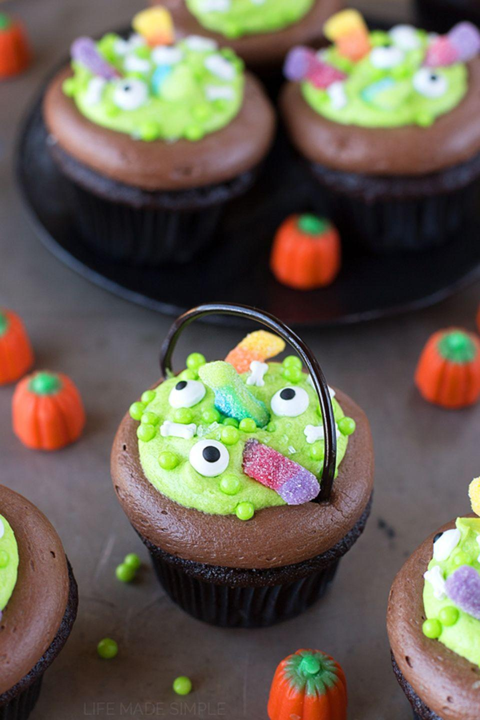 """<p>Ever wondered what's brewing in a witch's cauldron? In this case, it's a yummy """"scream"""" filling!</p><p><strong>Get the recipe at <a href=""""https://lifemadesimplebakes.com/2014/10/witchs-cauldron-chocolate-cupcakes/"""" rel=""""nofollow noopener"""" target=""""_blank"""" data-ylk=""""slk:Life Made Simple"""" class=""""link rapid-noclick-resp"""">Life Made Simple</a>.</strong></p>"""