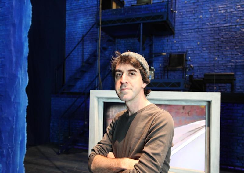 """This Wednesday, March 27, 2013 photo shows songwriter Jason Robert Brown at Second Stage Theatre, where a revival of his show """"The Last Five Years"""" is playing, in New York. The song cycle debuted in New York in 2002 and, despite a short run, has become a staple in regional theaters and colleges. (AP Photo/Mark Kennedy)"""