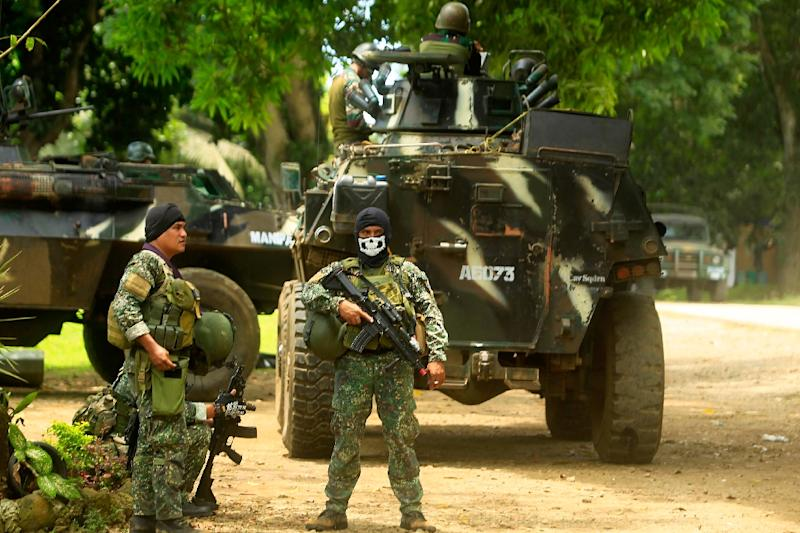 Philippine troops are battling Islamist militants on the southern island of Jolo where the Abu Sayyaf group is holding more than a dozen hostages including several foreigners