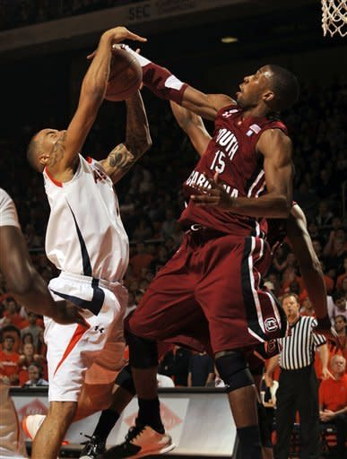 South Carolina's Malik Cooke, right, blocks the shot of Auburn's Josh Langford in the first half of an NCAA college basketball game on Saturday, Jan. 21, 2012 in Auburn, Ala.(AP Photo/Todd J. Van Emst)