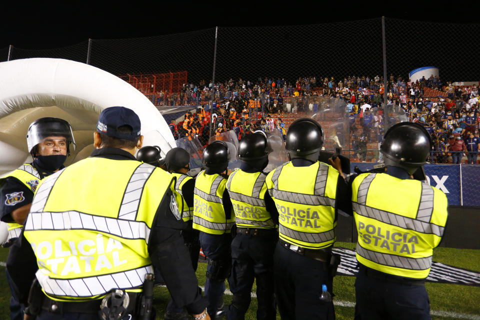 SAN LUIS POTOSI, MEXICO - APRIL 29: Members of the security staff stand guard in front of the stands after the 17th round match between Atletico San Luis and Pachuca as part of the Torneo Guard1anes 2021 Liga MX at Estadio Alfonso Lastras on April 29, 2021 in San Luis Potosi, Mexico. (Photo by Leopoldo Smith/Getty Images)