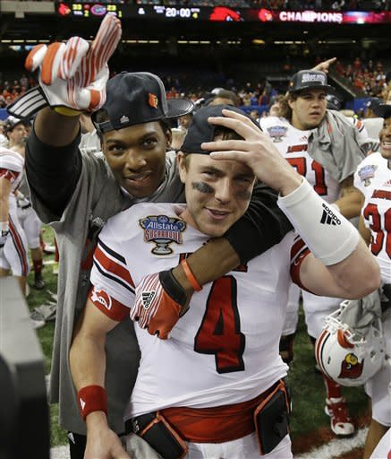 Louisville quarterback Will Stein (4) reacts with teammates following a 33-23 win over Florida in the Sugar Bowl NCAA college football game Wednesday, Jan. 2, 2013, in New Orleans. (AP Photo/Bill Haber)