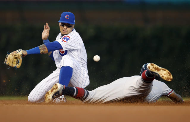 Atlanta Braves' Ronald Acuna Jr., right, slides safely into second with a stolen base as Chicago Cubs' Javier Baez loses the ball during the fourth inning of a baseball game Monday, June 24, 2019, in Chicago. (AP Photo/Jim Young)