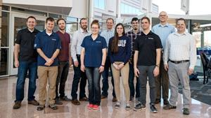 Members of the Space Dynamics Laboratory HARP team pose for this photo on February 19, 2020, at SDL's headquarters in North Logan, Utah, the day HARP was deployed from the International Space Station. Pictured from left to right are Bryan Hansen, Camren Hansen, Jaden Miller, Matt Jeppesen, Hannah Brailsford, Jason Hansen, Jenny Hinton, Cameron Weston, David Allen, Ryan Martineau, and Tim Neilsen. (Credit: Ben Sharp/Space Dynamics Laboratory)
