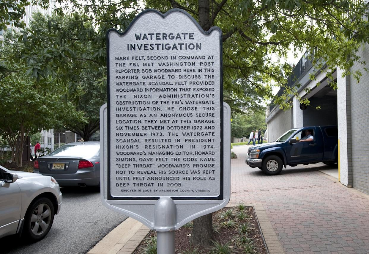 A historical marker on August 19, 2011 notes the parking garage in the Rosslyn neighborhood of Arlington, Virginia, where Washington Post reporter Bob Woodward met in secret with his source 'Deep Throat' (Senior FBI official Mark Felt) as Woodward investigated former US President Richard Nixon and the Watergate scandal in 1972 and 1973. The scandal ultimately lead to Nixon's resignation in 1974. AFP PHOTO / Saul LOEB (Photo credit should read SAUL LOEB/AFP/Getty Images)