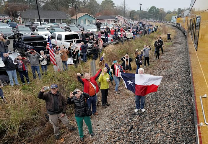 People pay their respects as the train carrying the casket of former President George H.W. Bush passes Thursday, Dec. 6, 2018, along the route from Spring to College Station, Texas. (Photo: David J. Phillip/Pool via Reuters)
