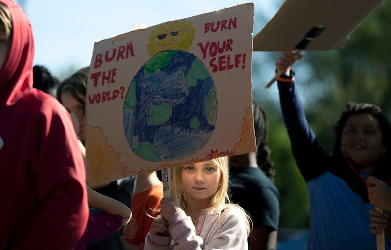 """ign while participating in a """"Global Climate Strike"""" at the Experiential School of Greensboro in Greensboro, N.C., on Friday, Sept. 20, 2019. (Photo: ASSOCIATED PRESS)"""
