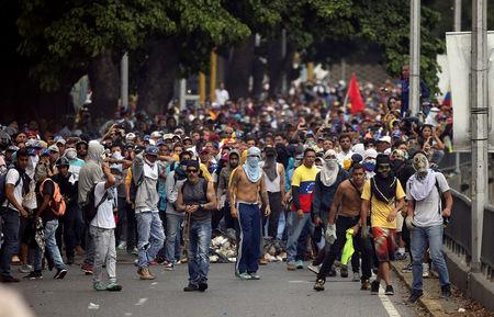 Demonstrators clash with the riot police during a rally in Caracas, Venezuela