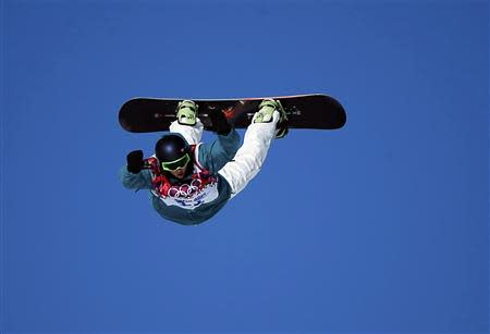 Australia's Scotty James performs a jump during the men's snowboard slopestyle semi-final competition at the 2014 Sochi Olympic Games in Rosa Khutor February 8, 2014. REUTERS/Mike Blake