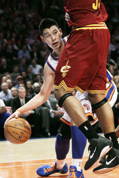 New York Knicks guard Jeremy Lin (17) looks for room around Cleveland Cavaliers forward Alonzo Gee (33) in the first half of their NBA basketball game at New York's Madison Square Garden, Wednesday, Feb. 29, 2012. (AP Photo/Kathy Willens)