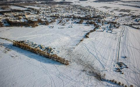 The wreckage site where the plane crashed after taking off from Moscow - Credit: AFP