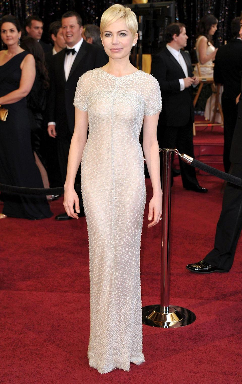 <p>Best Actress nominee Michelle Williams wowed in an elegant beaded Chanel Haute Couture gown and cropped haircut. </p>