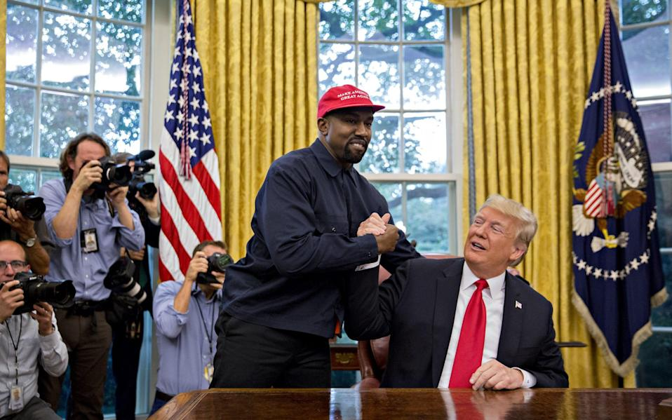Rapper Kanye West, left, shakes hands with U.S. President Donald Trump  - Andrew Harrer /Bloomberg