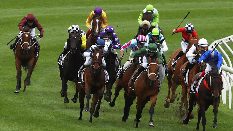 Horses are pictured racing at the Flemington Racecourse in Melbourne.