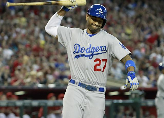 PHOENIX, AZ - MAY 18: Matt Kemp #27 of the Los Angeles Dodgers reacts after lining out for the third out with the bases loaded against the Arizona Diamondbacks during the eighth inning of a MLB game at Chase Field on May 18, 2014 in Phoenix, Arizona. (Photo by Ralph Freso/Getty Images)