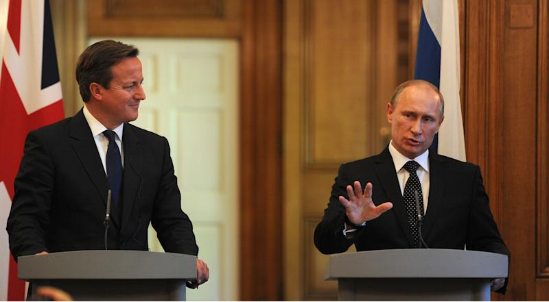 British Prime Minister David Cameron, left, and Russian President Vladimir Putin, during a press conference at 10 Downing Street, London, Sunday June 16, 2013. Cameron meets with Russian President Putin for talks on the Syrian crisis amid fears that differences between Moscow and the West are pushing the two sides towards a new Cold War. (AP/Anthony Devlin, PA Wire) UK OUT - NO SALES - NO ARCHIVES