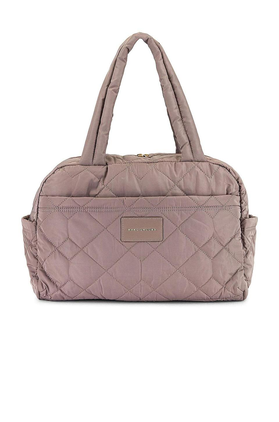 <p>If you're looking for a pretty and practical weekender that isn't oversized but still fits the necessities, this Marc Jacob bag is the solution. It's built for long weekends at the beach or lake, and with tons of compartments and pockets, you'll find it's easier to stay organized and find items in a flash. </p>