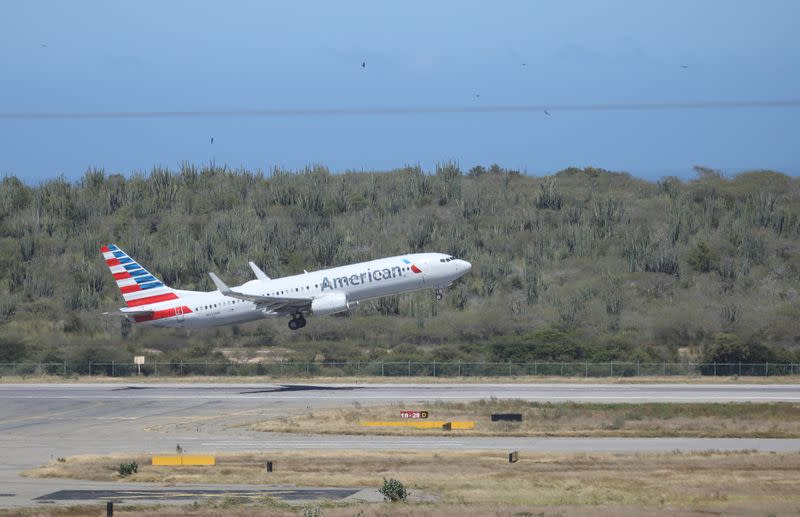 An American Airlines Boeing 737 airplane takes off at Simon Bolivar International Airport in Caracas