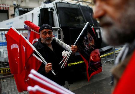 Street vendor sells Turkish flags during a protest in front of the Dutch Consulate in Istanbul