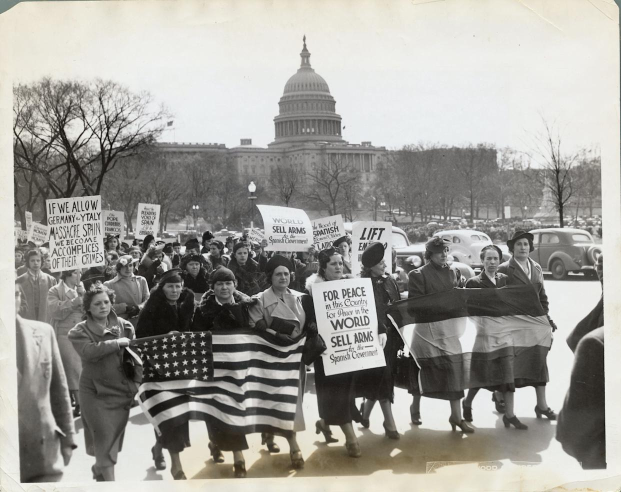 Over three thousand Spanish American women, representing 20,000 members of the united Committees of Spanish Women in America arrived by special train in Washington today to publicize the plight of Spain's women and children and urge our government to revoke the embargo government of Spain circa 1938. Photo shows the sympathizers marching to the State Department and the white House with hopes of seeing the president and the Secretary of State. In the background can be seen the Capitol.