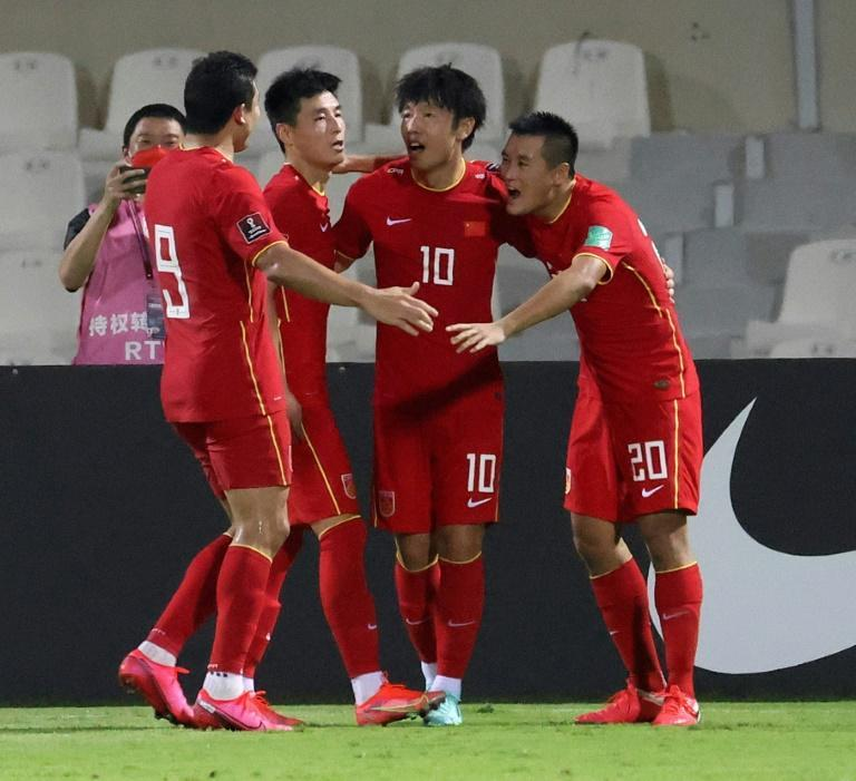 Chinese players celebrate beating Syria at the Sharjah Football Stadium to secure their place in the final qualifying round for Qatar 2022