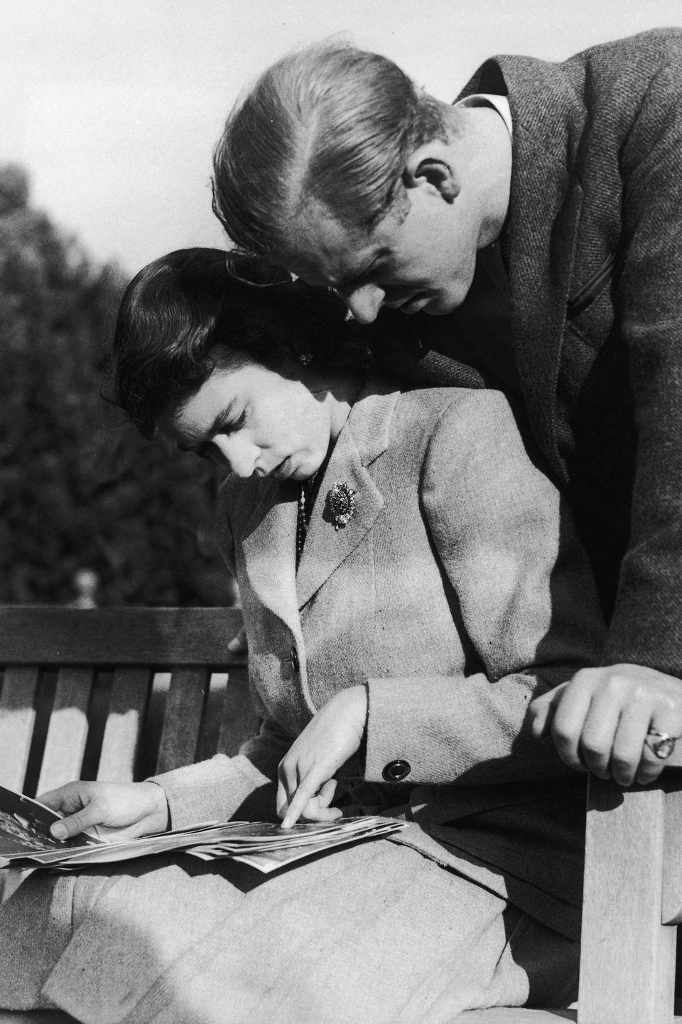 <p>The newlyweds look at their wedding photographs during their first honeymoon in Romsey, New Hampshire. Their second honeymoon was in Malta the following year.</p>